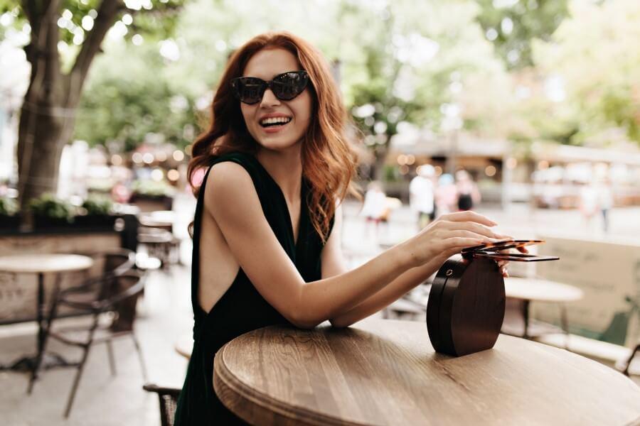joyful-woman-in-sunglasses